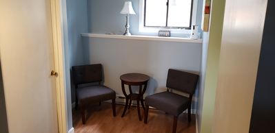 Entryway with bistro set (new floors coming soon)