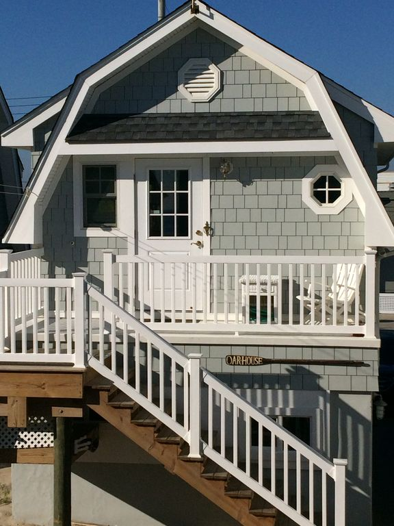 Entrance side of Oarhouse with new canopy over door & Cute Rental Apartment On Beach Front Property - VRBO