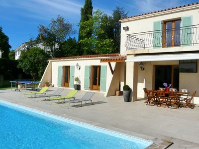 Photo for Modern holiday villa with large pool near golf course, tennis & town