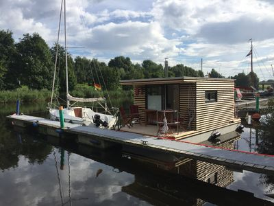 Photo for Houseboat HT 5; with fireplace for 2-3 persons in an idyllic location of Wilhelmshaven