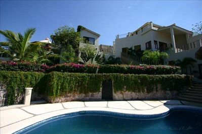 View of villa with beautiful garden.