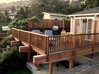 View of rear deck and house. Rental is the upper level only. Ping-pong not incl.