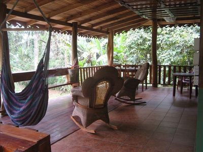 Large deck overlooks the beach to the front and the jungle forest to all side.