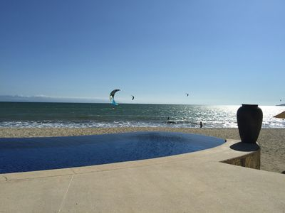 Relax and enjoy the infinity pool, beach and ocean from the private beach club.