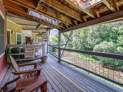 Photo for NEW LISTING! Historic downtown condo with a shared deck overlooking the river!