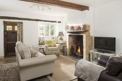 Sitting room with open log fire