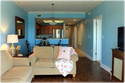 """Living Room with 50"""" smart tv. Balcony can entered from living room."""