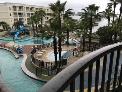 View from our 3rd Floor Balcony--the Waterpark with the Lazy River  and the Bay