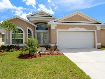 Photo for Stunning 4 Bedroom, 2 suite home with a private games room and pool!