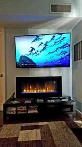 """New 58""""Smart 4K TV, Faux LCD Fireplace w/ heat, Blu-Ray Player,   and Sound Bar."""