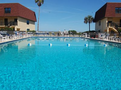 Photo for 117 Cocoa Beach Club Direct Oceanfront Next to Pier, Dog Friendly, New Baths