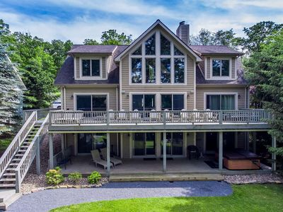 Photo for Waterfront chalet w/ large deck, 5 master suites, hot tub,& pool table!