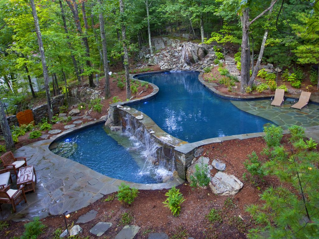 aerial view of the pool area - Cool Pools With Waterfalls In Houses