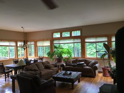 Upstairs Living Room. Panoramic views of the private woods