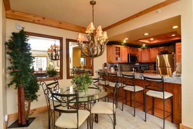Dining area near kitchen, seating for 4 at table, plus 4 at breakfast bar.