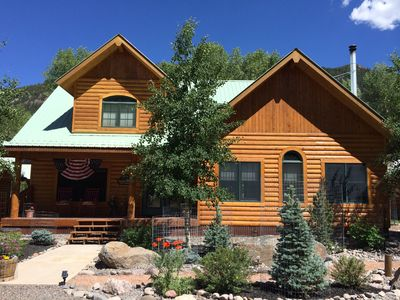 Photo for RIVERFRONT LOG CABIN, IMMACULATE, BEAUTIFULLY FURNISHED, BLOCKS FROM TOWN!