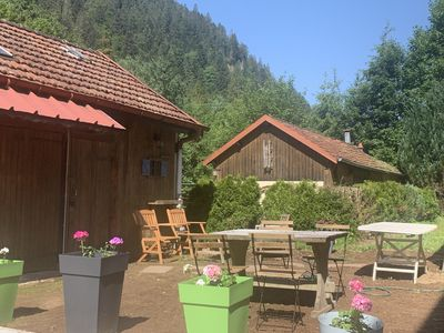 Photo for Large charming refuge at the water's edge in Gérardmer. Spa / sauna / Wifi