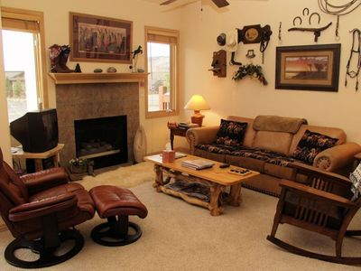Living Room with Leather Furniture, Fireplace, Entertainment Center, Balcony