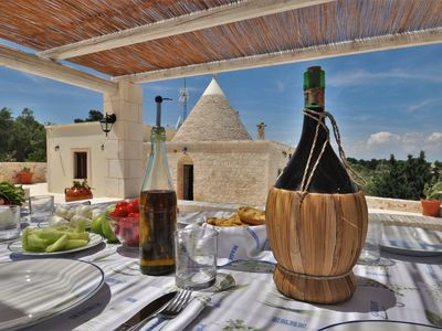 Photo for Typical rural Trullo with exclusive private pool, ideal for couples and families