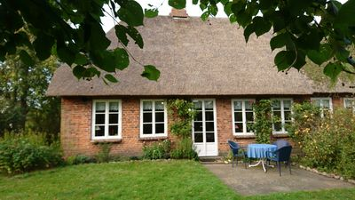 Photo for Comfortably furnished thatched roof house with a large garden