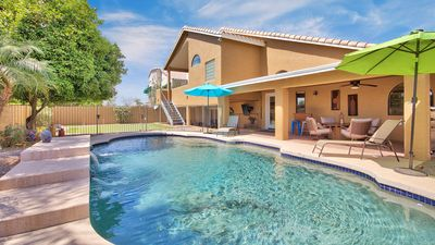 Photo for **PUTTING GREEN + POOL**  This beautiful 5 bedroom house sleeps up to 14 people