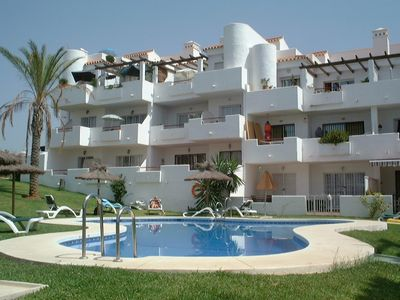 Photo for Fantastic penthouse 2 bed apartment with pool, terrace & sea views