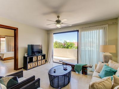 Photo for Relaxing condo great for families w/ outdoor jetted tub - steps from the beach!
