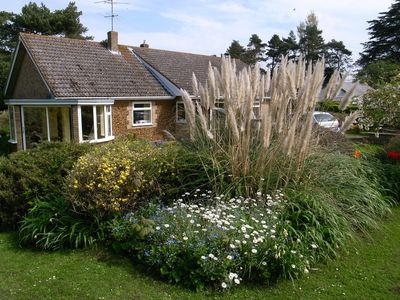Photo for Bungalow with cottage garden close to sandy beach.  Sleeps 4 and free Wi-fi.