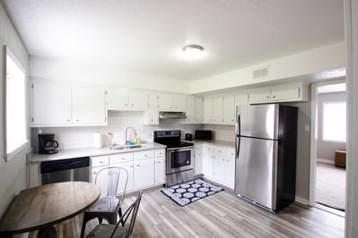 Beautiful upgraded kitchen with stainless steel appliances + granite countertops