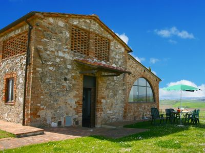 Photo for Farmhouse with unique views, pool and private terrace in the Crete Senesi