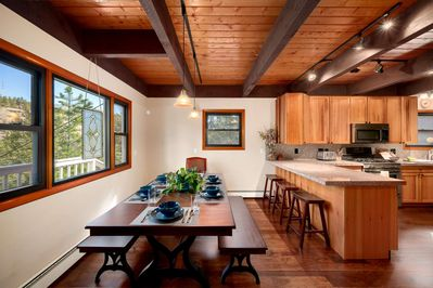 Eat-in kitchen with farmhouse table and extra seating at the counter.