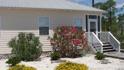 Photo for Charming 3BD cottage minutes from beach with pool view