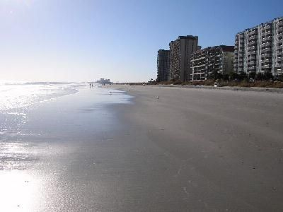 Looking South on the  beach from in front of the condo.