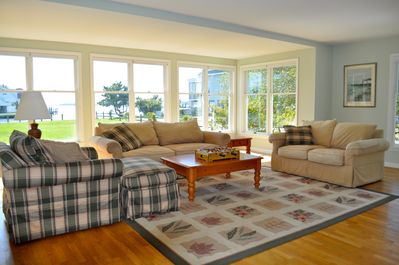 The living room has a large screen TV, fireplace and a beautiful bay view.