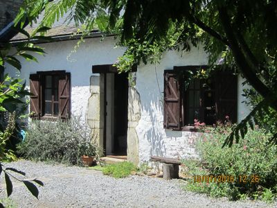 Photo for 17th Century cottage nestling in the Pyrenean foothills with solar heated pool