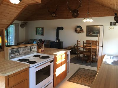Nice galley style kitchen with large island with extra seating.
