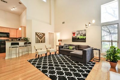 Living Room - The open living room boasts high, cathedral-style ceilings.