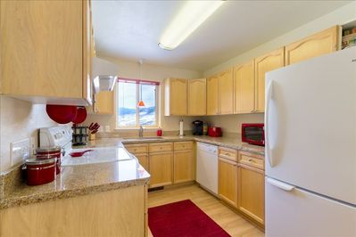 Open kitchen - fully equipped with granite counters and breakfast bar