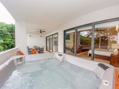 Photo for Top Notch 3BR condo with Jacuzzi around the corner from the beach by Happy Address