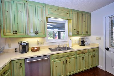 Well appointed kitchen has plenty of counter space for cooking meals in.