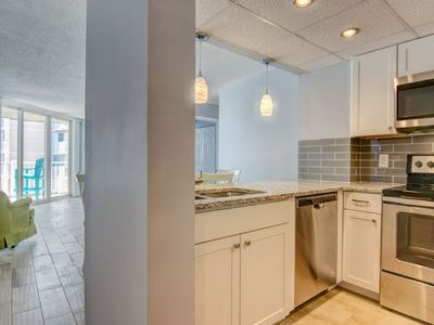 Photo for UPDATED Oceanfront Unit, Steps to the Beach