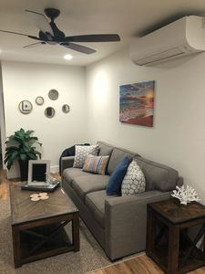 Spacious living room with pullout sleeper sofa, ceiling fan and TV