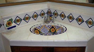 Guest bathroom with beautiful hand painted sink.