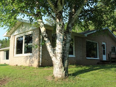 Photo for North Woods Getaway. Huge riverfront home 14 acres
