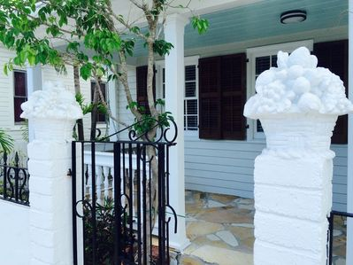 Artistic Cuban cornucopia add grace to the iron gate front entrance.