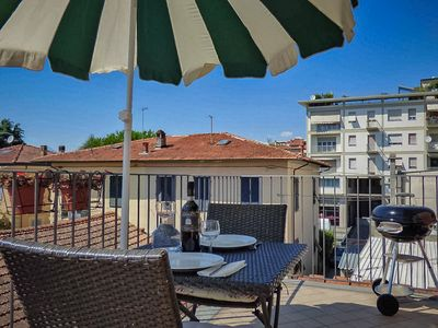 Photo for Lucca apartment with private terrace. Parking on the street. FREE WIFI & A/C.