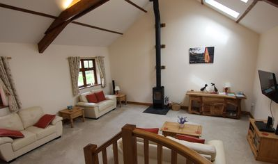 Spacious vaulted lounge with log burner, TV and DVD player.