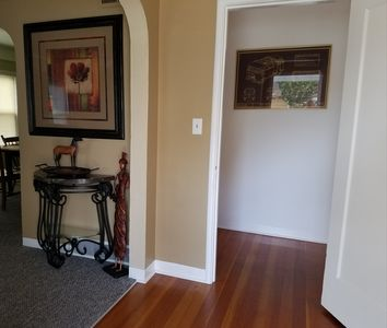 Foyer With Door To Hallway On Right & Living Room And Dining Room To The Left