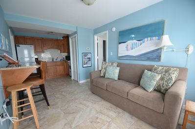 Enter in to this bright and beachy decor.  With a queen sofa, counter seating, and full kitchen this is where most of the fun will happen.  Both bedrooms are located off of this common area.