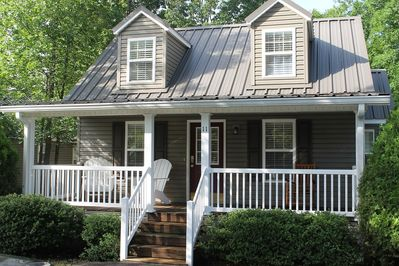 Large front porch w/ adirondack chairs.
